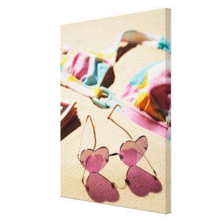 Bikini Top And Heart Shape Sunglasses On Beach Canvas Print