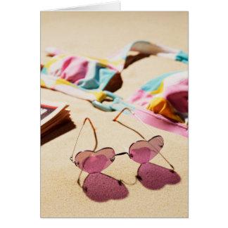 Bikini Top And Heart Shape Sunglasses On Beach Card