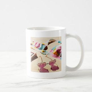 Bikini Top And Heart Shape Sunglasses On Beach Coffee Mug