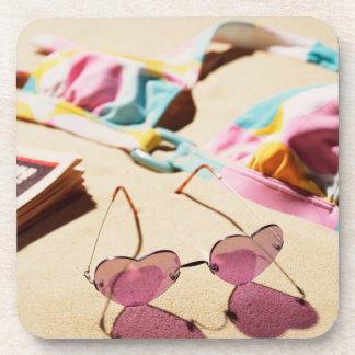 Bikini Top And Heart Shape Sunglasses On Beach Drink Coaster