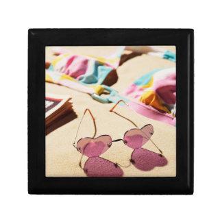 Bikini Top And Heart Shape Sunglasses On Beach Gift Box