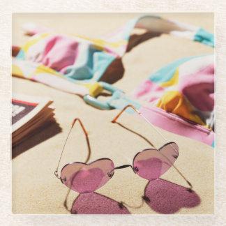 Bikini Top And Heart Shape Sunglasses On Beach Glass Coaster