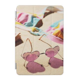 Bikini Top And Heart Shape Sunglasses On Beach iPad Mini Cover