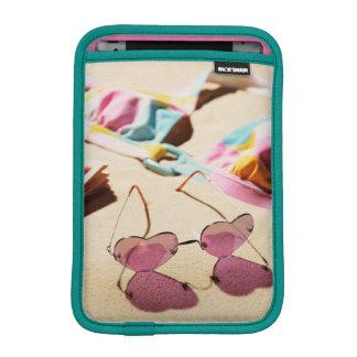 Bikini Top And Heart Shape Sunglasses On Beach iPad Mini Sleeve