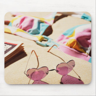 Bikini Top And Heart Shape Sunglasses On Beach Mouse Pad