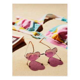 Bikini Top And Heart Shape Sunglasses On Beach Postcard