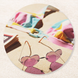 Bikini Top And Heart Shape Sunglasses On Beach Round Paper Coaster