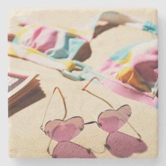 Bikini Top And Heart Shape Sunglasses On Beach Stone Coaster