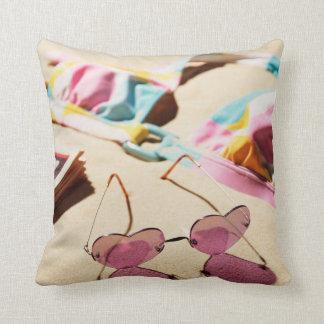 Bikini Top And Heart Shape Sunglasses On Beach Throw Pillow