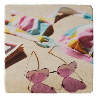 Bikini Top And Heart Shape Sunglasses On Beach Trivet