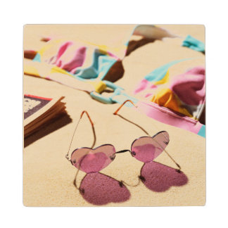 Bikini Top And Heart Shape Sunglasses On Beach Wooden Coaster