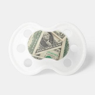 Billetes de dólar uno chupete de bebé