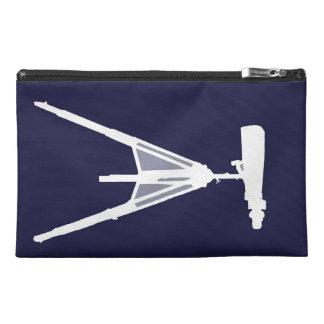 Binoculars on plain navy blue background. travel accessory bag