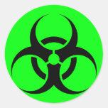 Bio peligro o verde de cuidado del símbolo de la m etiquetas redondas
