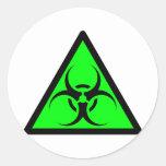 Bio peligro o verde de cuidado del símbolo de la etiquetas redondas