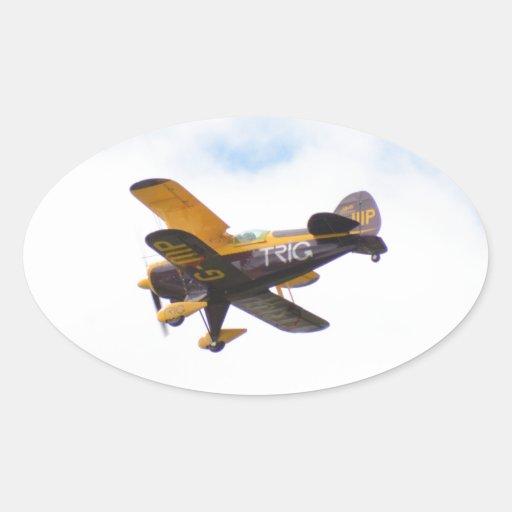 Biplano aeroacrobacia en vuelo colcomanias de oval