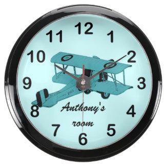 Biplano azul del vintage del juguete reloj acuario