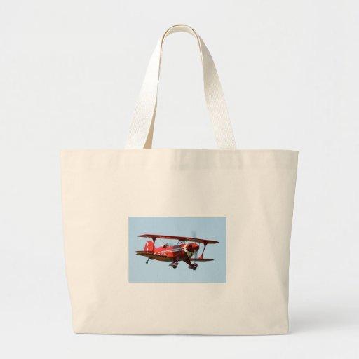 Biplano rojo bolsas