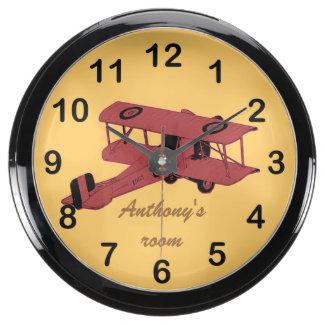 Biplano rojo del vintage del juguete reloj aqua clock