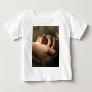bird asleep in hands baby T-Shirt