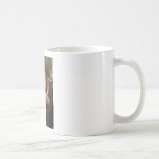 bird asleep in hands coffee mugs