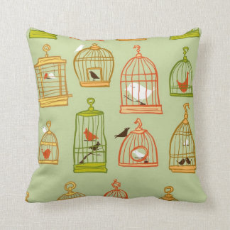 Bird Cages on Green Pillows