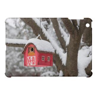 Bird house on tree in winter iPad mini case
