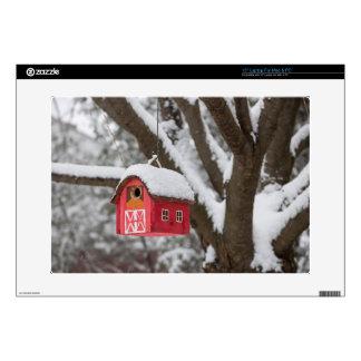 Bird house on tree in winter laptop skins