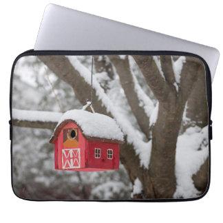 Bird house on tree in winter laptop sleeve