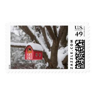 Bird house on tree in winter postage