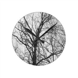 bird in a tree wall clock