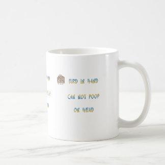 Bird in hand can not poop on head coffee mug