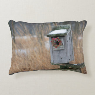 Bird, nest box with holiday wreath in winter accent pillow