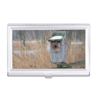 Bird, nest box with holiday wreath in winter case for business cards