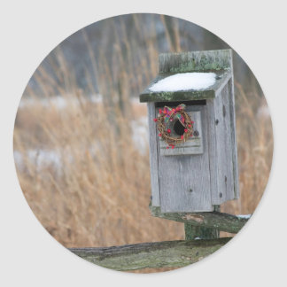 Bird, nest box with holiday wreath in winter classic round sticker