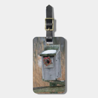 Bird, nest box with holiday wreath in winter luggage tag