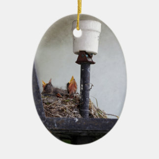 Bird nest in a street lamp. ceramic ornament