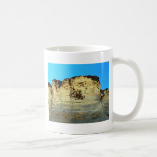 bird nests on rock face coffee mug