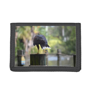 bird of prey back view on log foot up trifold wallet