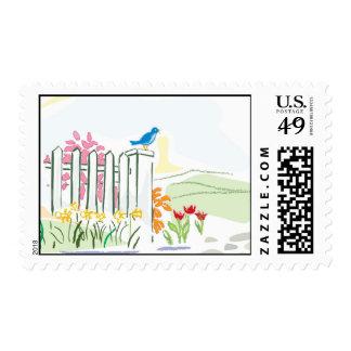 Bird on fence postage stamp