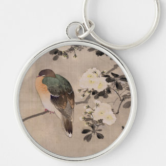 Bird perched on a branch of a blossoming tree Silver-Colored round keychain