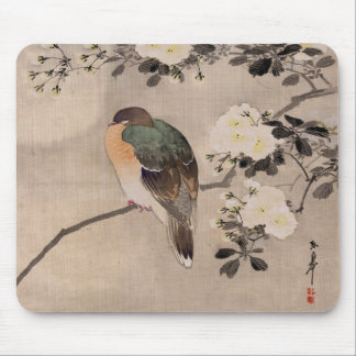 Bird perched on a branch of a blossoming tree mousepads