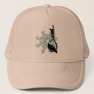 BIRD RESTING ON A NOOSE TRUCKER HAT