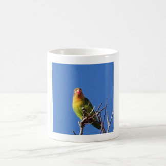 Bird singing in winter coffee mug