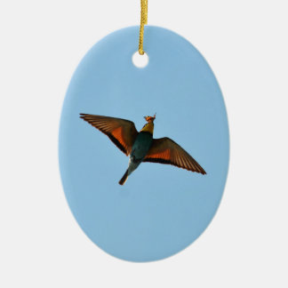 Bird With Butterfly In Beak Double-Sided Oval Ceramic Christmas Ornament