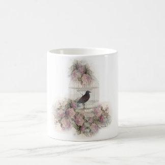 Birdcage with purple rose coffee mug