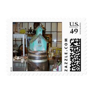 Birdhouse antiguo en un sello del barril de cervez