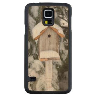 Birdhouse near pine tree in winter carved® maple galaxy s5 slim case