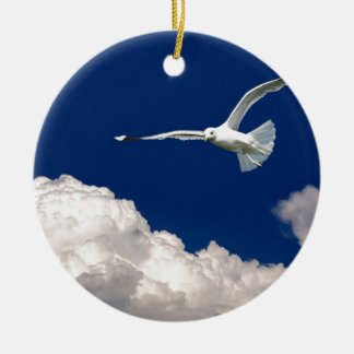 Birds fly in the blue sky over clouds ceramic ornament