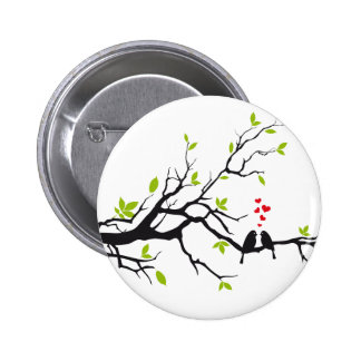 Birds in love with red hearts on spring tree button
